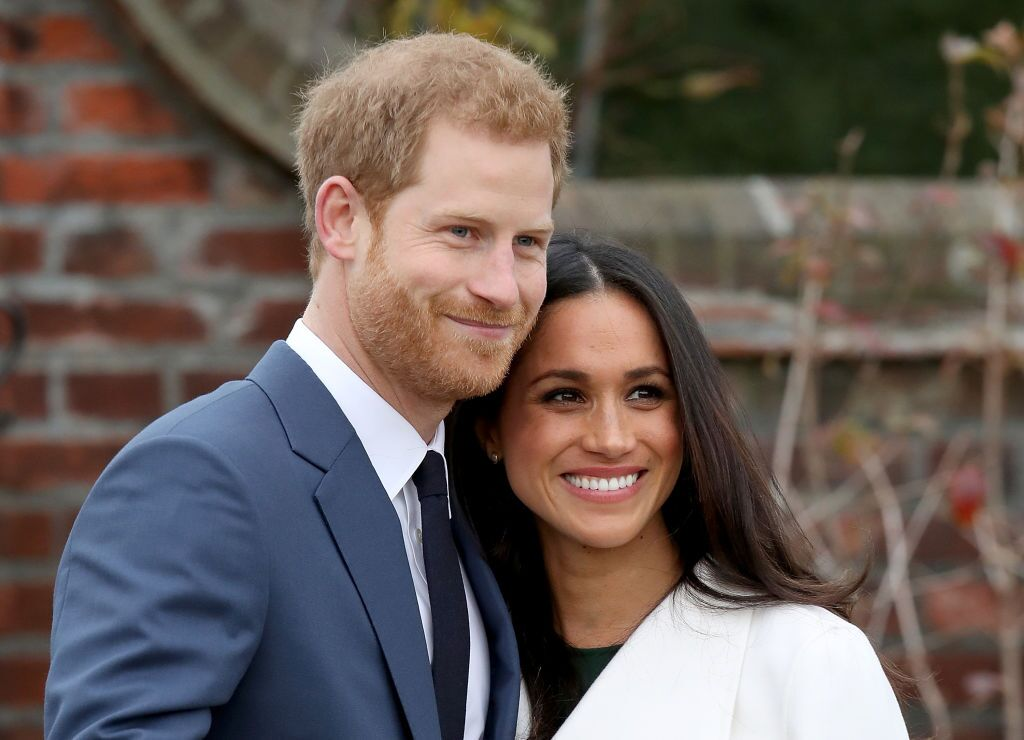 Prince Harry and Meghan Markle during an official photocall to announce their engagement at The Sunken Gardens at Kensington Palace on November 27, 2017 in London, England | Photo: Getty Images