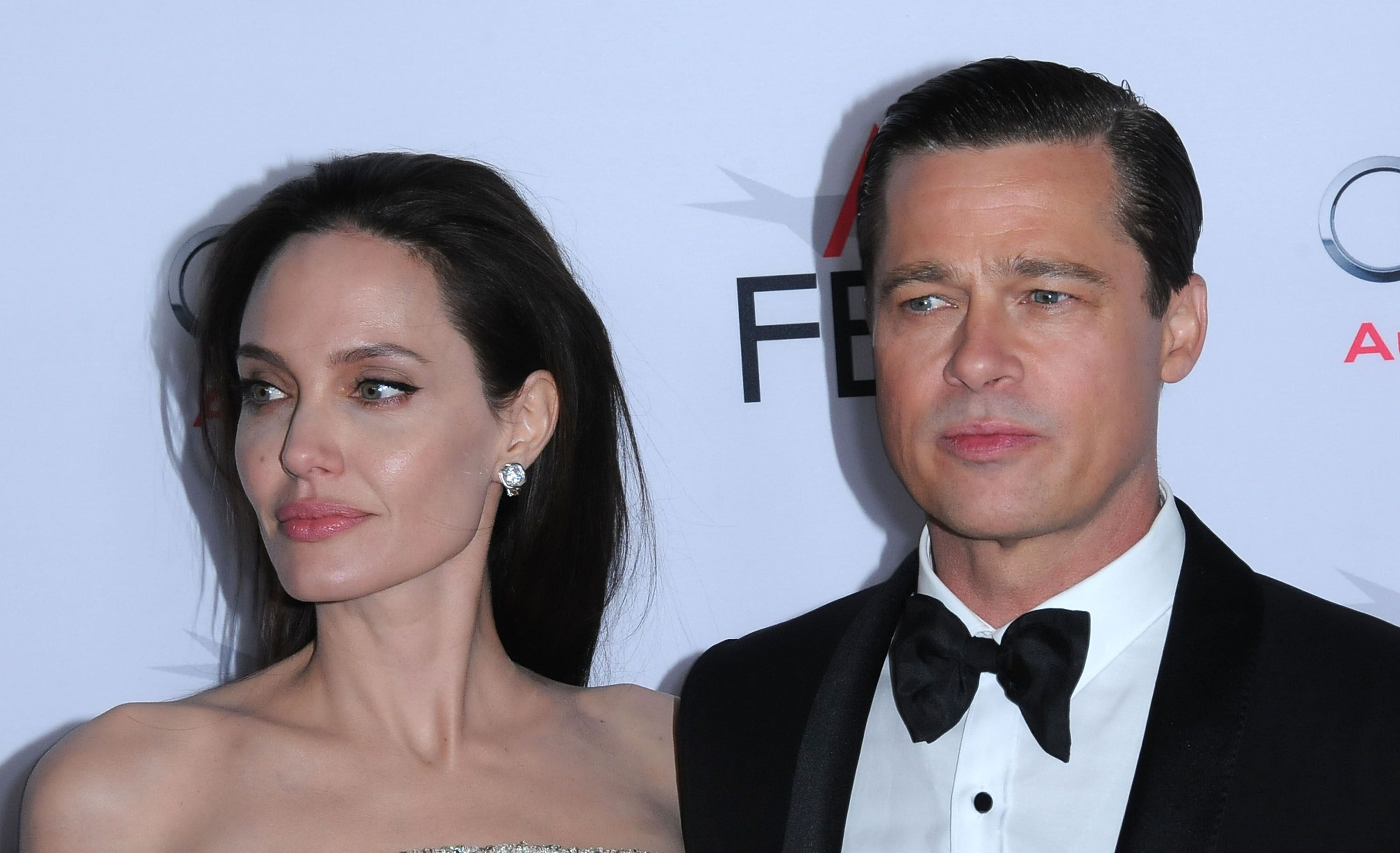 Actress Angelina Jolie and actor Brad Pitt arrive at AFI FEST 2015 | Photo: Getty Images