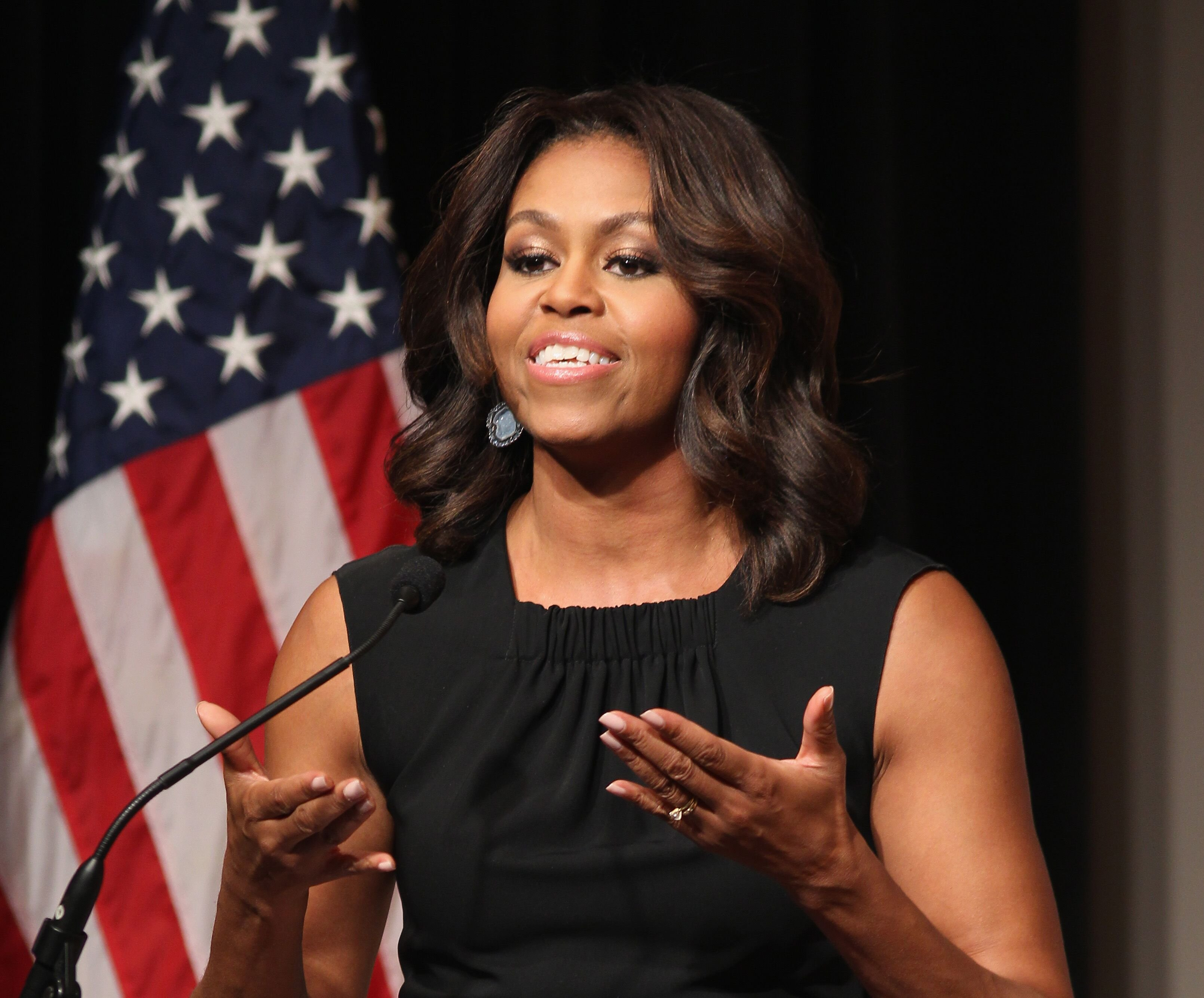 The former First Lady of the United States Michelle Obama speaks on stage at the Women Veterans Career Development Forum at Women in Military Service for America Memorial on November 10, 2014 | Photo: Getty Images