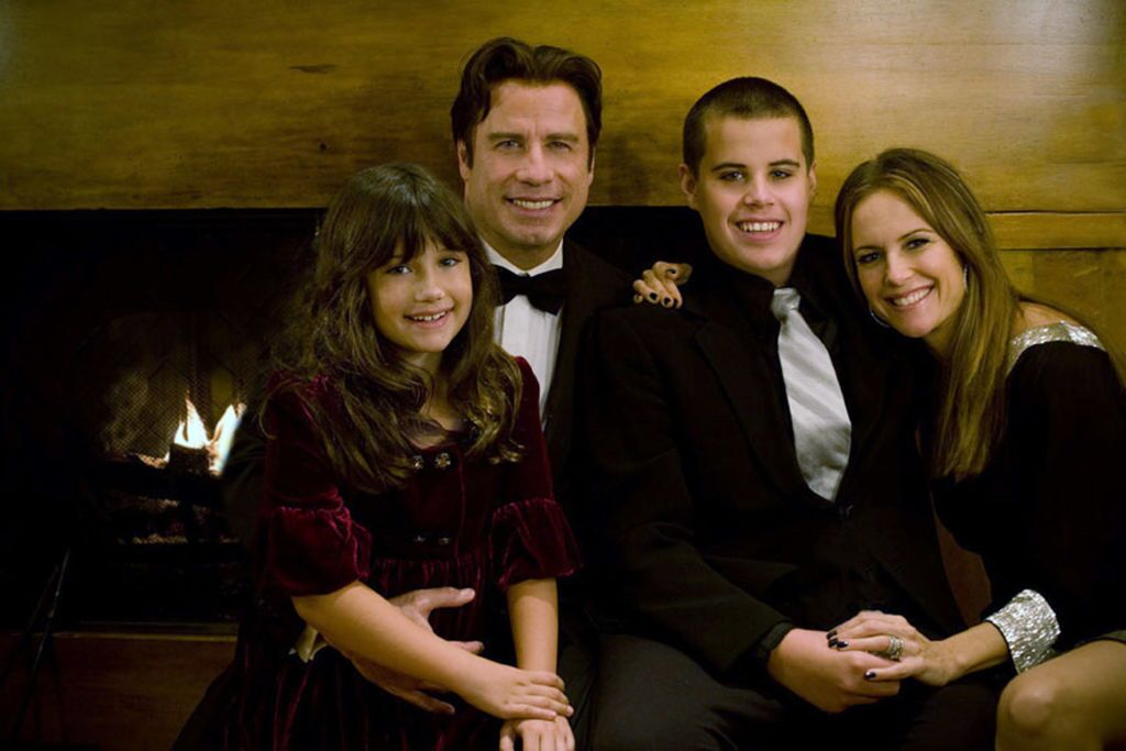 John Travolta (2nd L), his wife Kelly Preston (R) and their children Jett (2nd R) and Ella pose | Getty Images