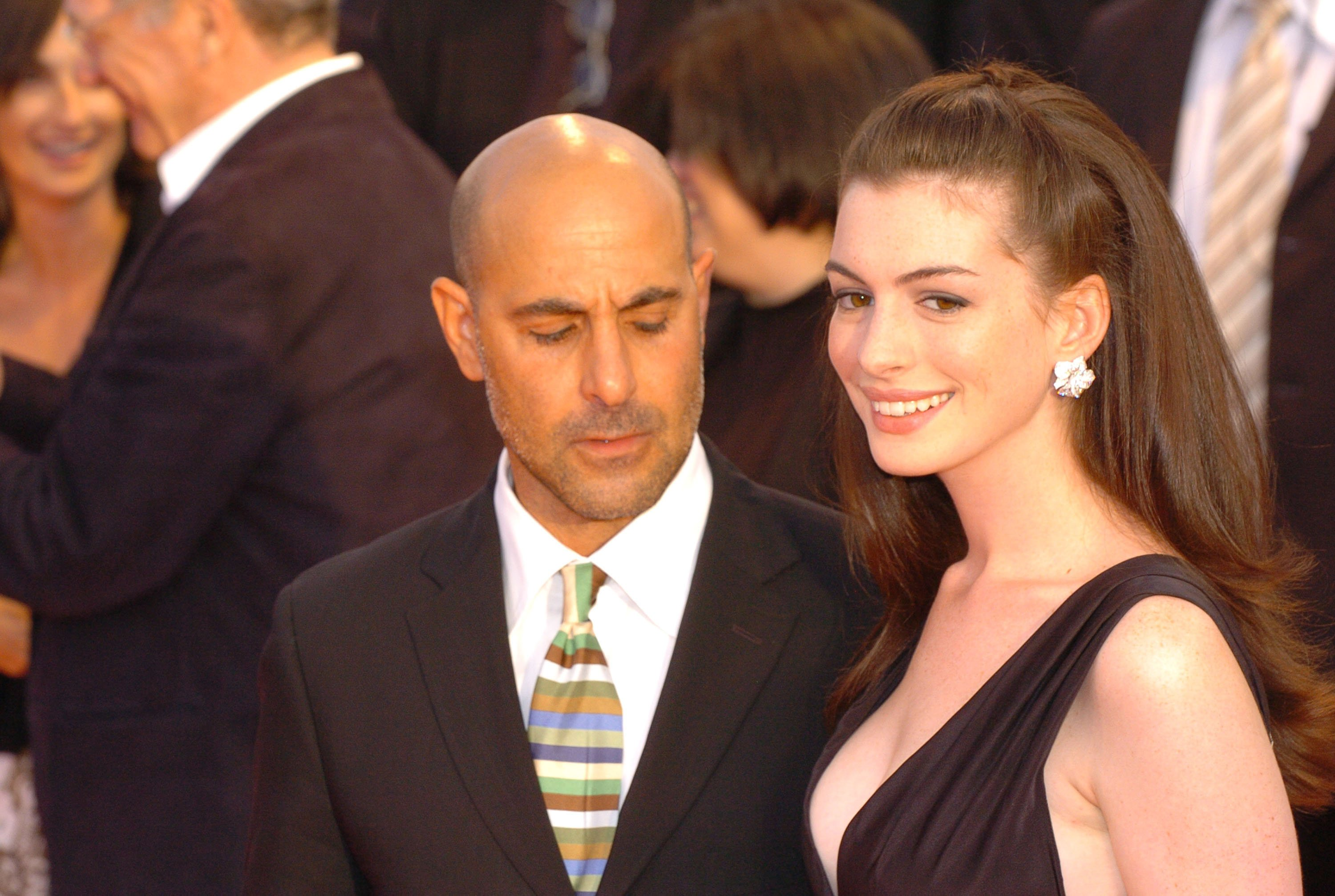 """Anne Hathaway and Stanley Tucci pictured at """"The Devil Wears Prada"""" premiere, 2006. 