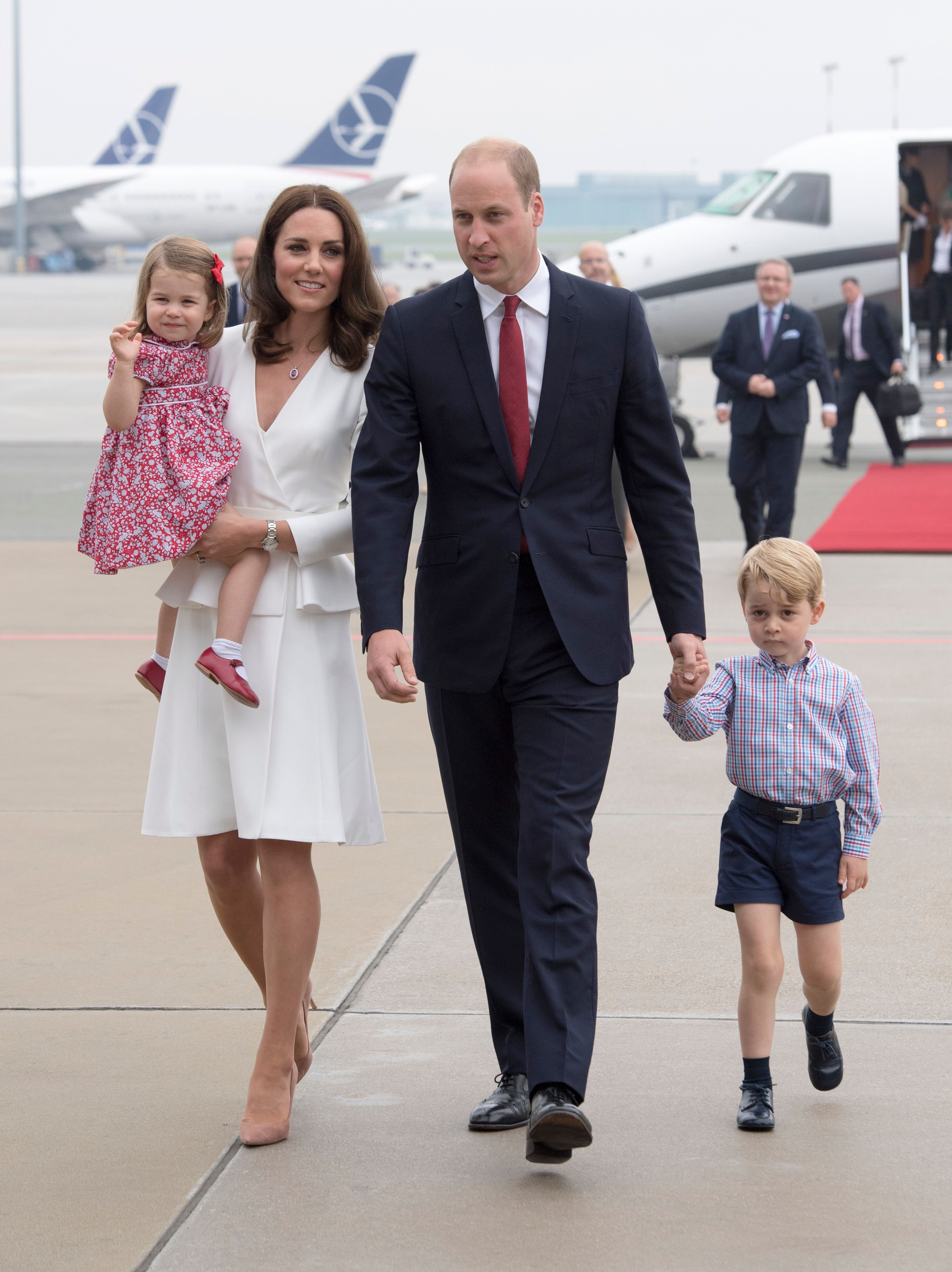 Prince William, Kate Middleton with their children Prince George and Princess Charlotte arrive at Warsaw airport to start a 3 day tour on July 17, 2017 in Warsaw, Poland | Photo: Getty Images