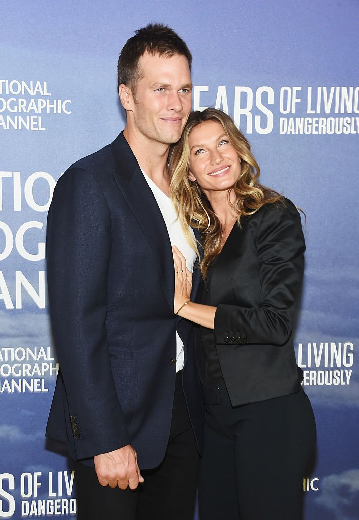 """Tom Brady and Gisele Bundchen attending National Geographic's """"Years Of Living Dangerously"""" premiere Source 
