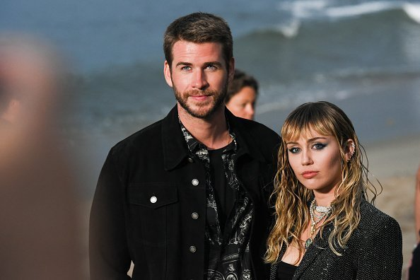 Liam Hemsworth and Miley Cyrus at Saint Laurent mens spring summer 20 show on June 06, 2019 | Photo: Getty Images