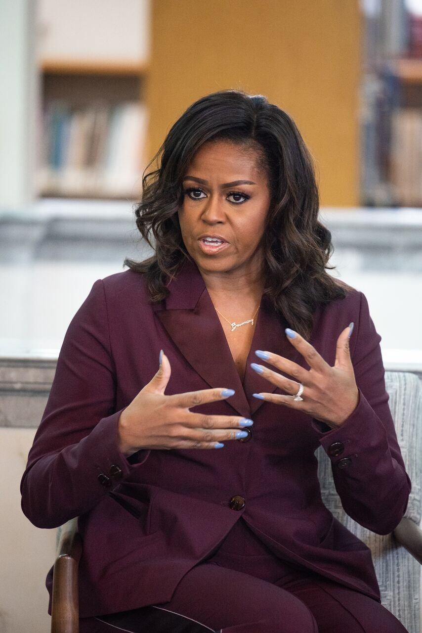 """Michelle Obama speaks with members of a local book group to discuss her book """"Becoming.""""   Source: Getty Images"""