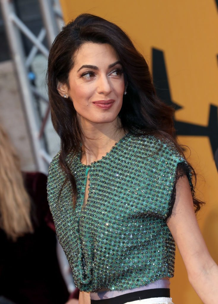 Amal Alamuddin Clooney attends 'Catch-22' Photocall at The Space Moderno Cinema | Photo: Getty Images