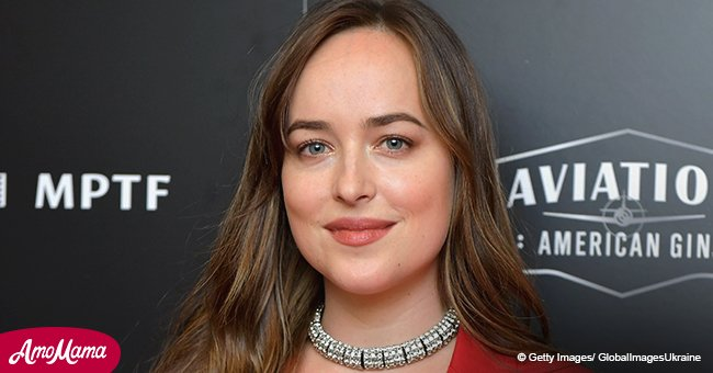 Dakota Johnson shares kiss with a mystery man while running errands without her beau Chris Martin