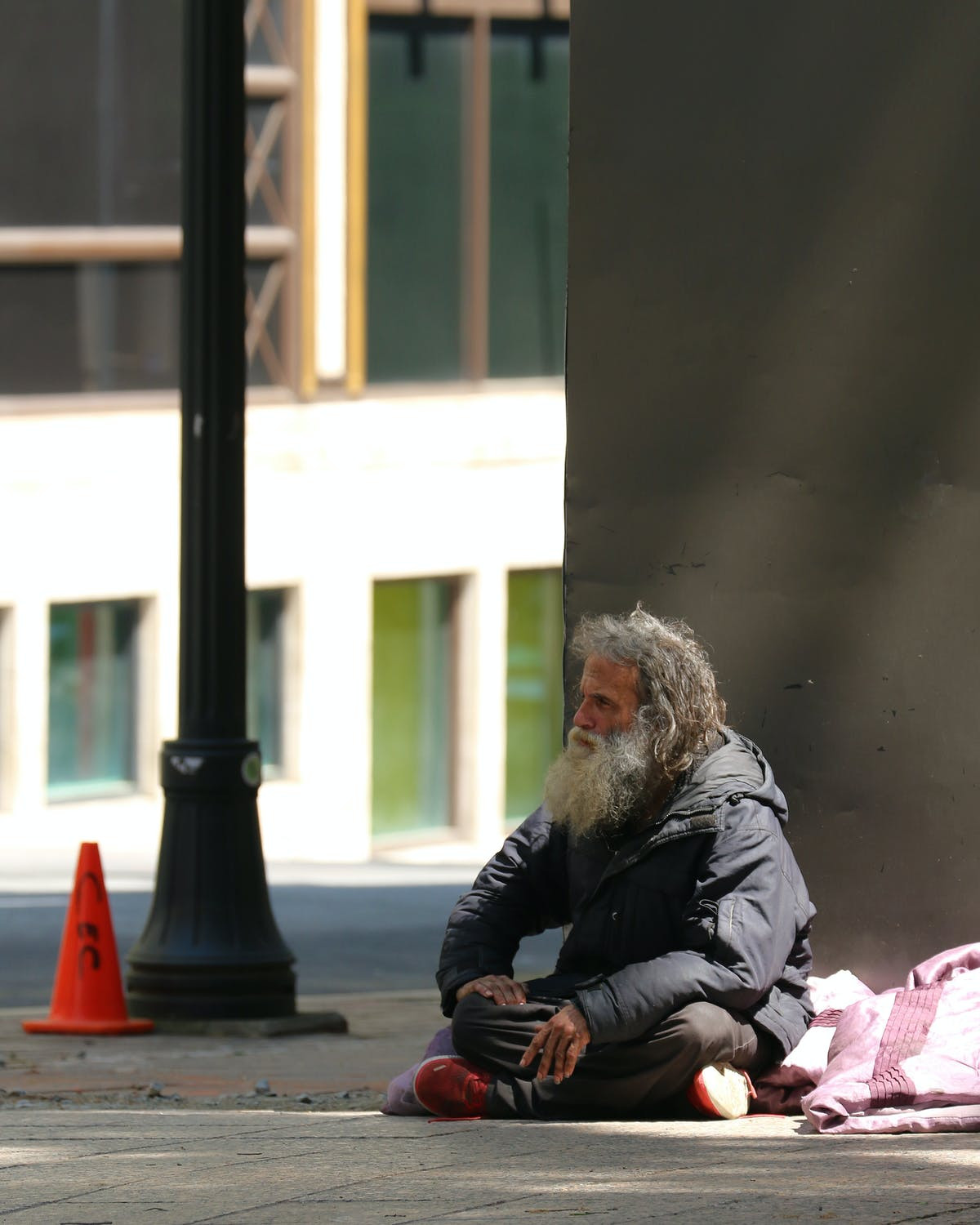 A homeless man had taken up residence by the side of the main door   Source: Pexels