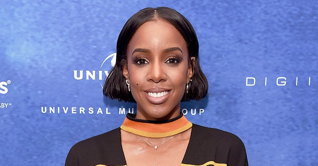 Check Out Kelly Rowland Showing off Her Growing Baby Bump in Tight Black Jumpsuit in New Selfie