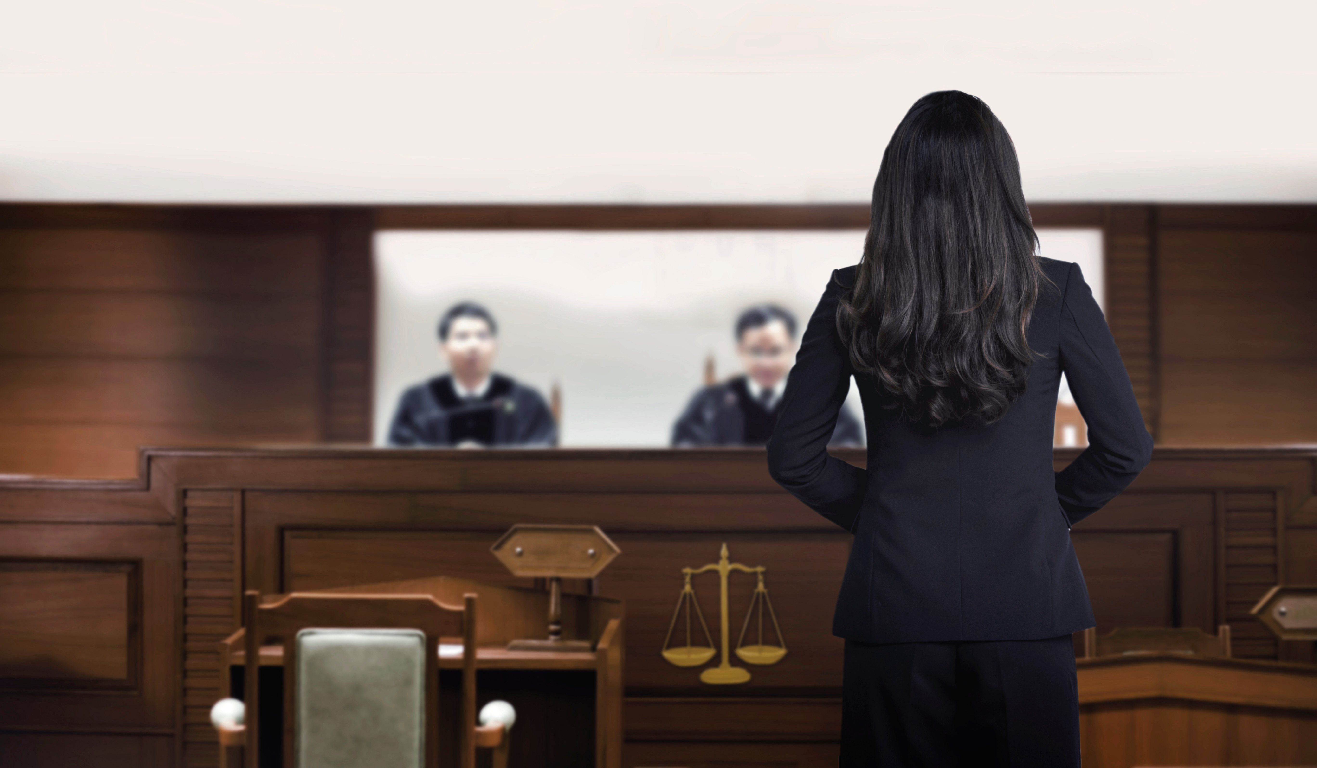 A female attorney in a courtroom talking to magistrate in court box   Photo: Shutterstock