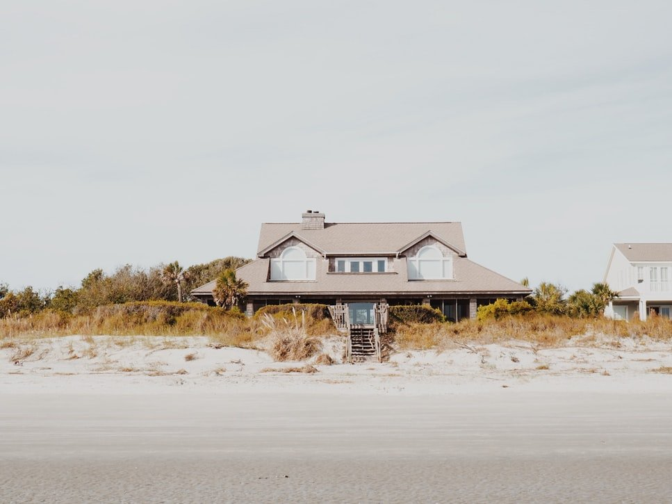 A pretty cottage by the sea   Source: Unsplash