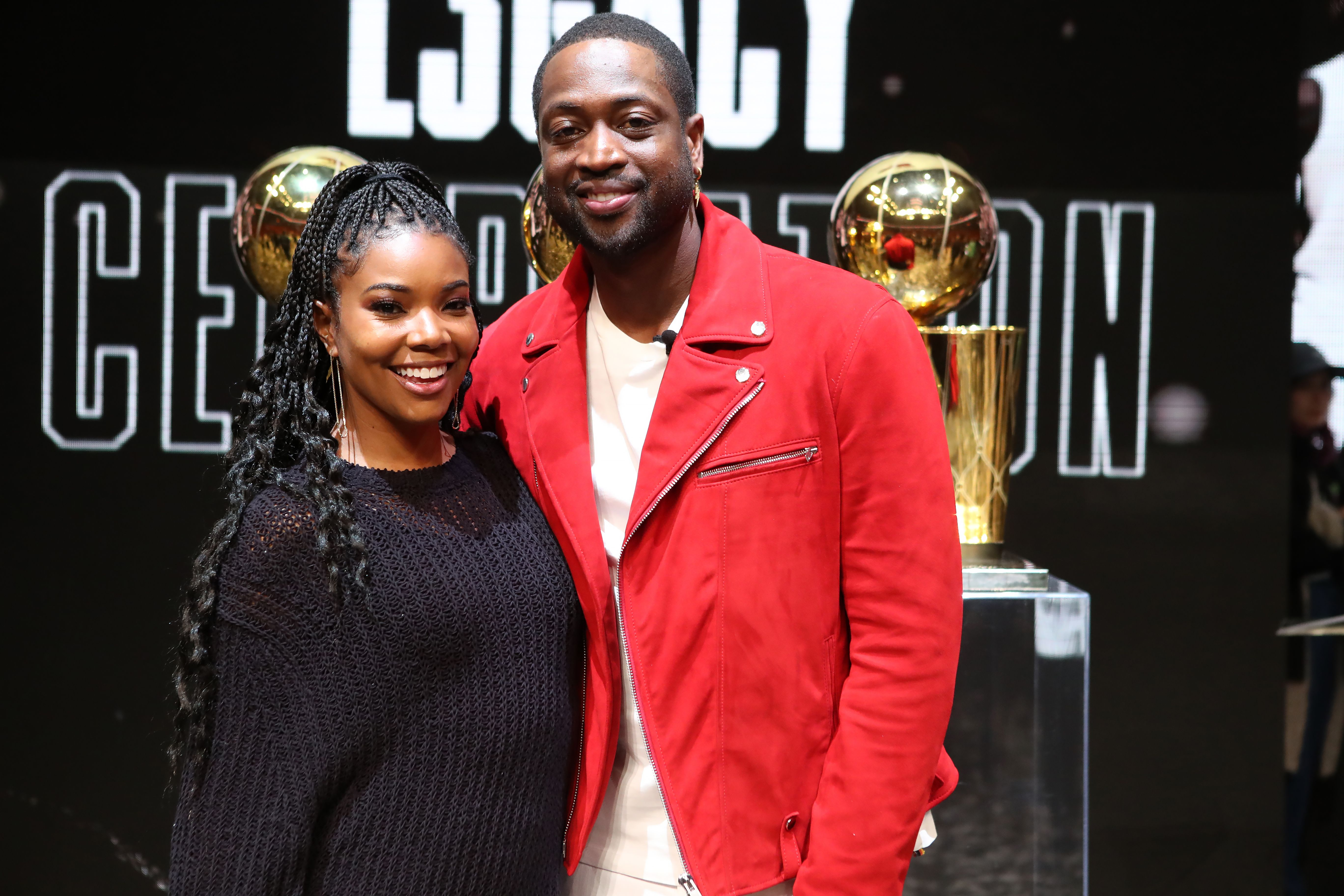 NBA Legend Dwyane Wade poses for a photo with his wife Gabrielle Union at the Jersey Retirement Flashback Event on February 21, 2020 | Photo: Getty Images