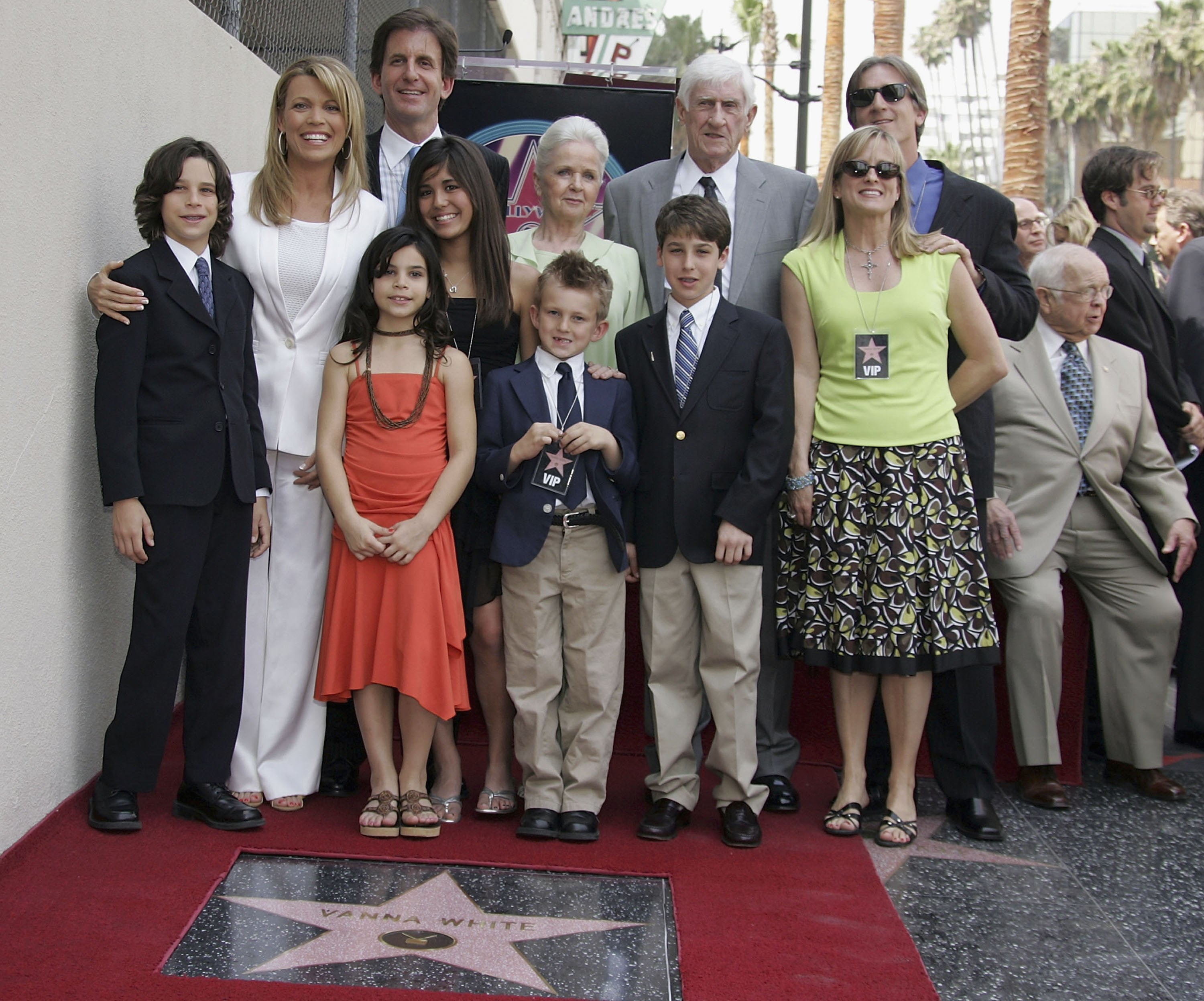 Wheel of Fortune Co-host Vanna White poses with family and friends after receiving A Star On The Walk Of Fame. | Source: Getty Images