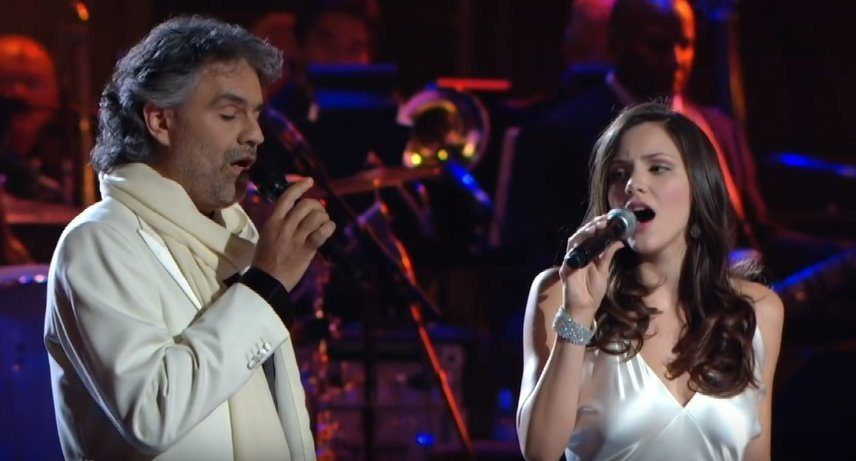 "Katharine McPhee watches Andrea Bocelli as the duo belt out emotional lyrics of the song ""The Prayer."" 