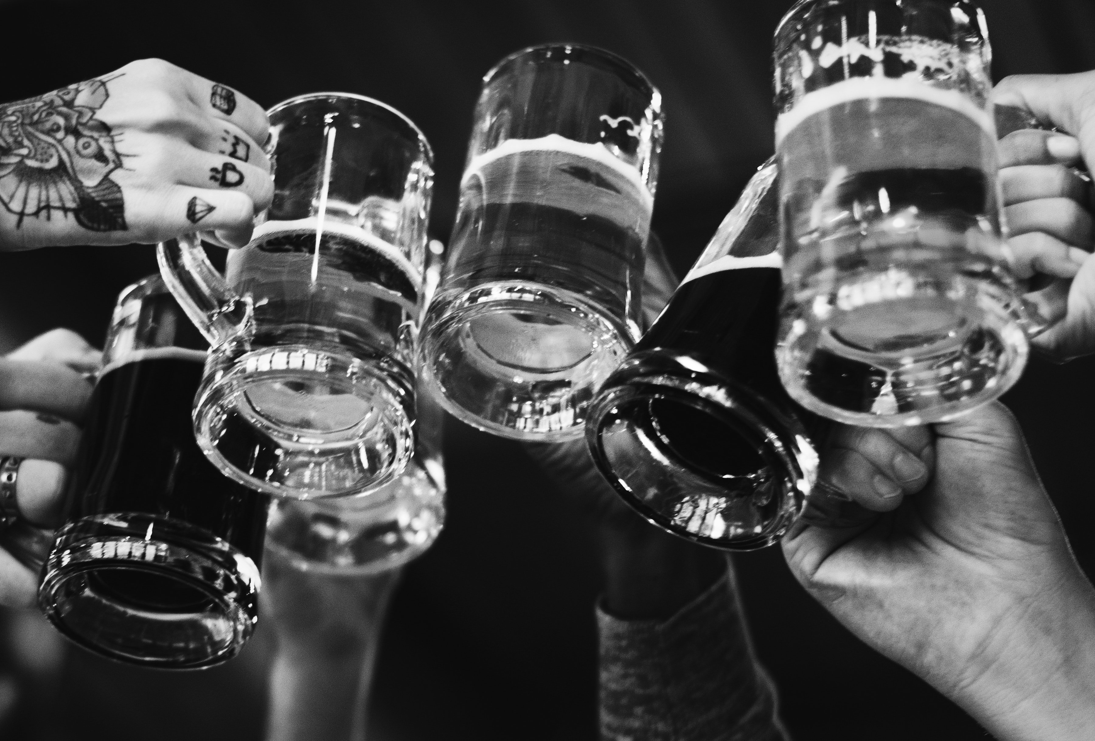People clinking beer glasses.  Source: Pexels