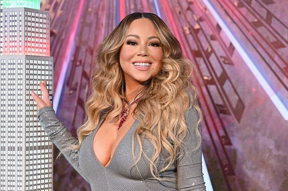 "Mariah Carey lights the Empire State Building in celebration of the 25th anniversary of ""All I Want For Christmas Is You"" at the Empire State Building on December 17, 2019 in New York City 