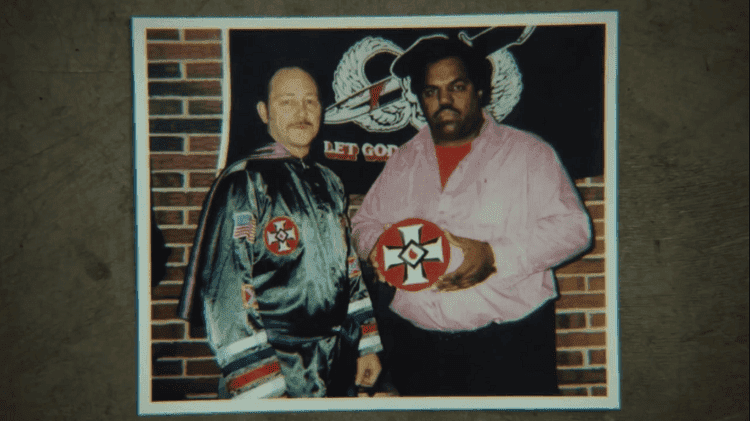 """Daryl Davis posing with a man wearing Ku Klux Klan attire shown in the trailer of the documentary film """"Accidental Courtesy"""" 