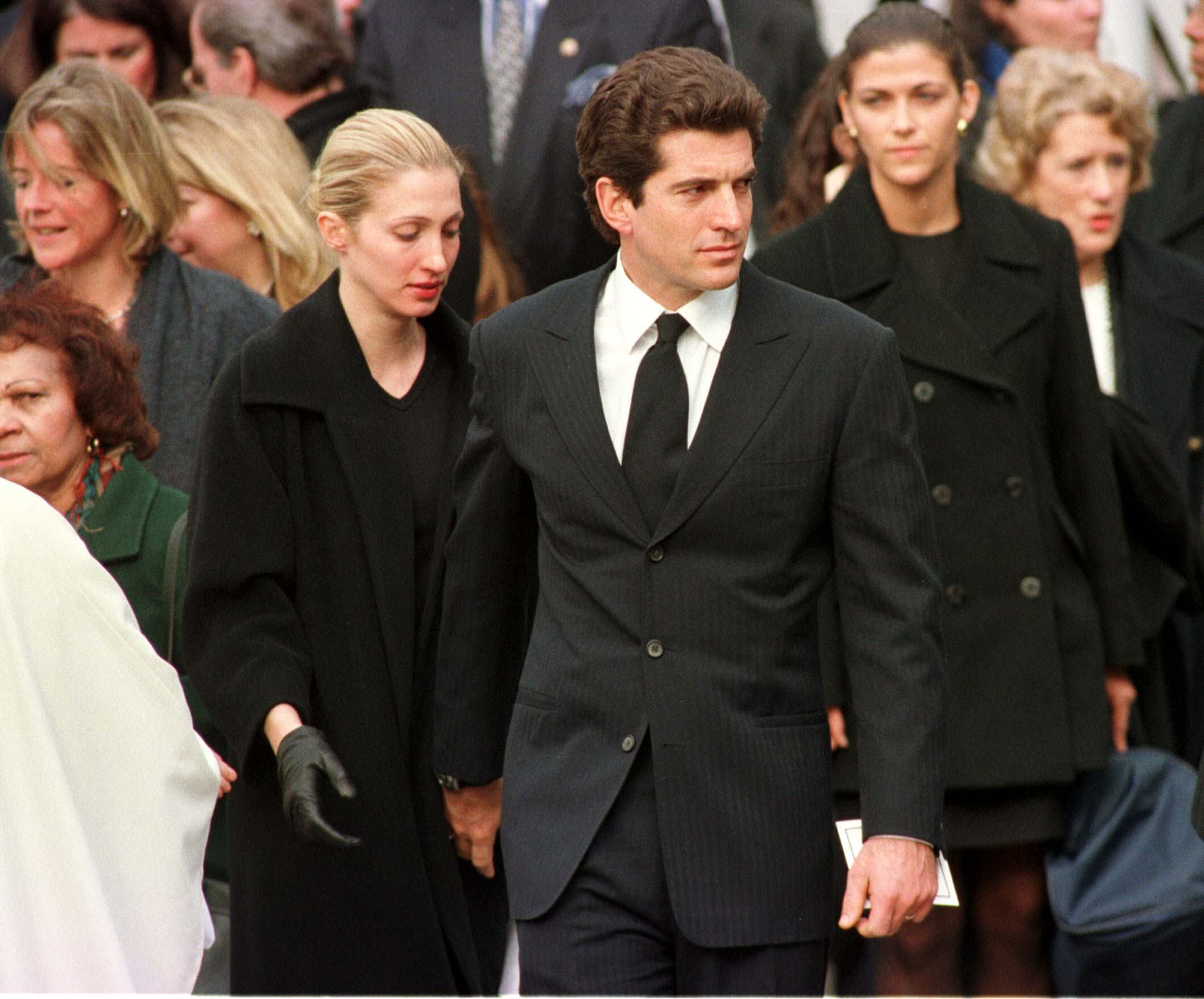 John F. Kennedy Jr. with his wife Carolyn after Michael Kennedy's funeral in Massachusetts on March 1, 1998. | Source: Getty Images.