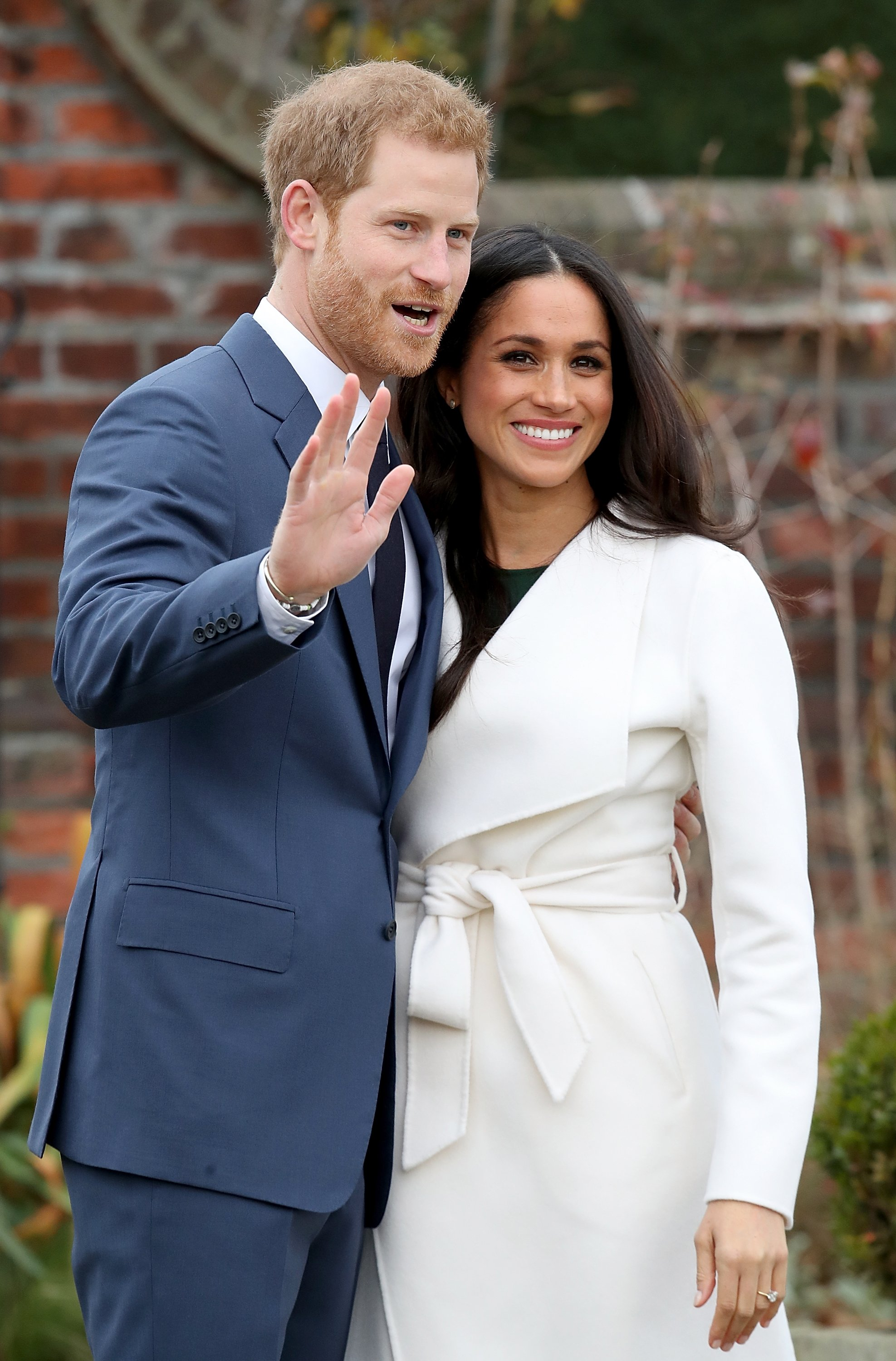 Prince Harry and Meghan Markle during an official photocall to announce their engagement at The Sunken Gardens at Kensington Palace on November 27, 2017. | Source: Getty Images