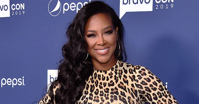 Watch Kenya Moore's Daughter Brooklyn Twirl in a Long Fringed White Dress for a Photo Shoot