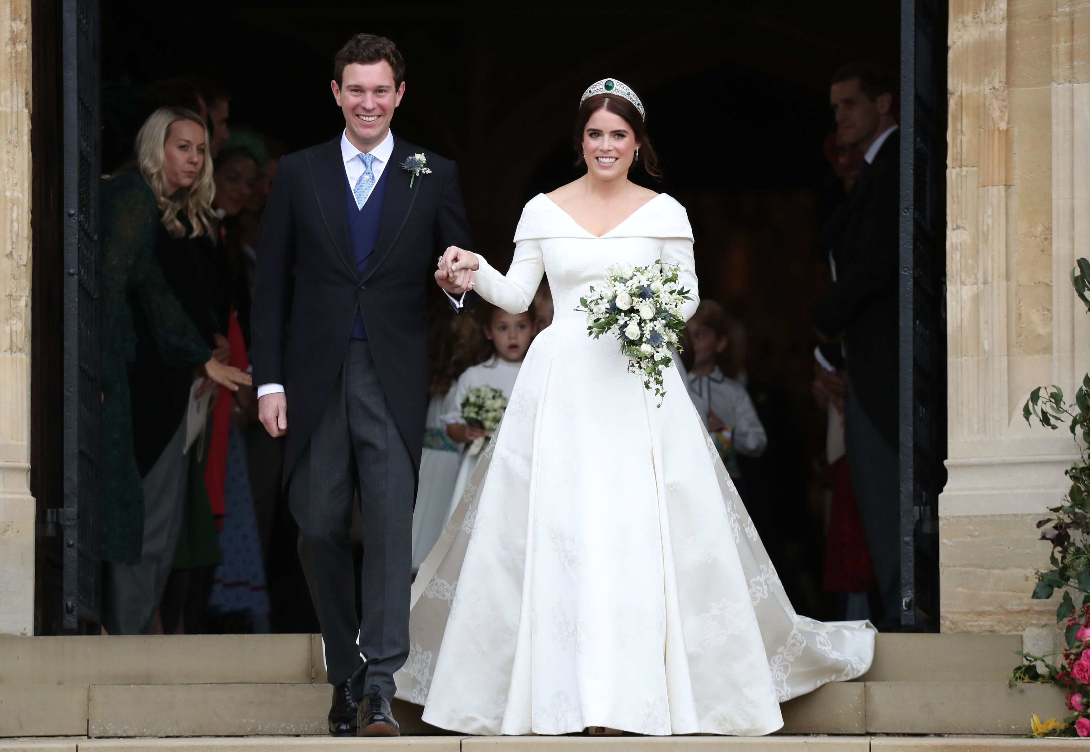 Princess Eugenie of York and her husband Jack Brooksbank on the steps of St George's Chapel after their wedding at St. George's Chapel on October 12, 2018 in Windsor, England | Photo: Getty Images
