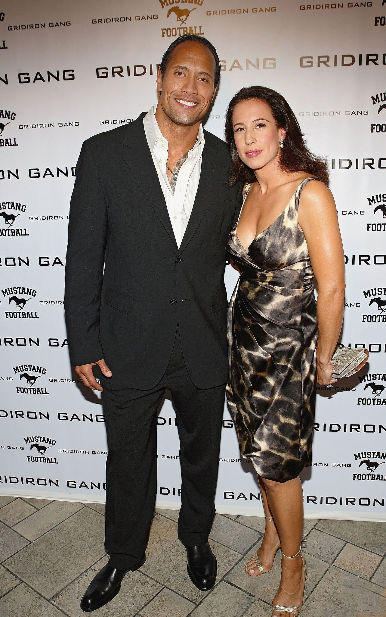 """Dwayne 'The Rock' Johnson (L) and his wife Dany Johnson (R) arrive at AMC Theatres in Sunset Place for the premiere of his new movie """"Gridiron Gang""""  