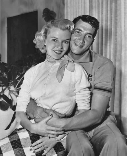 Actor and singer Dean Martin at home with his wife Jeanne Biegger between shoots for his film 'Jumping Jacks' in 1952. | Source: Getty Images