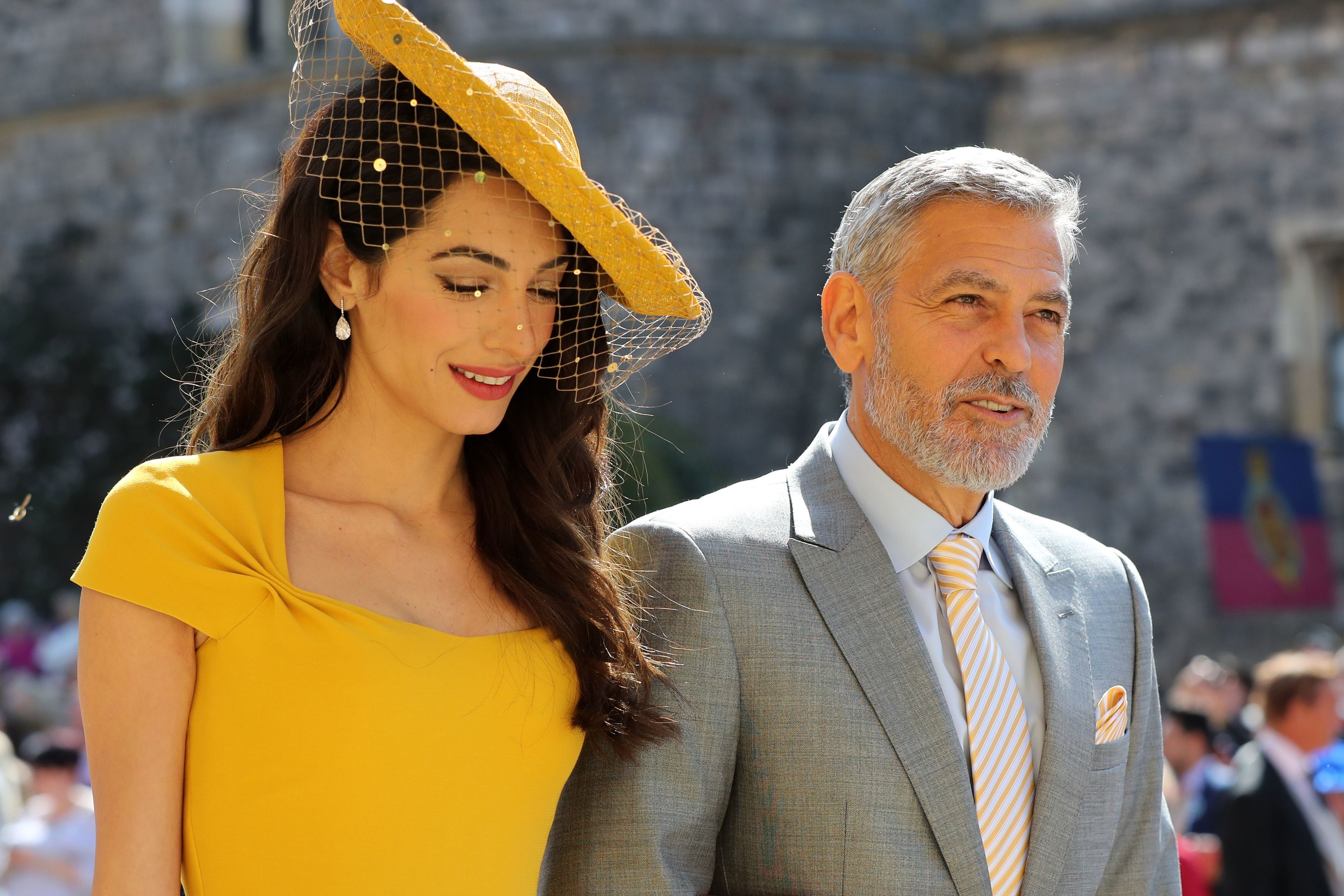 Amal and George Clooney arrive at St George's Chapel at Windsor Castle for the wedding of Prince Harry to Meghan Markle on May 19, 2018 | Source: Getty Images