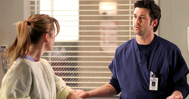 """Patrick Dempsey and Ellen Pompeo on the set of """"Greys Anatomy"""", December 2004   Source:Getty Images"""