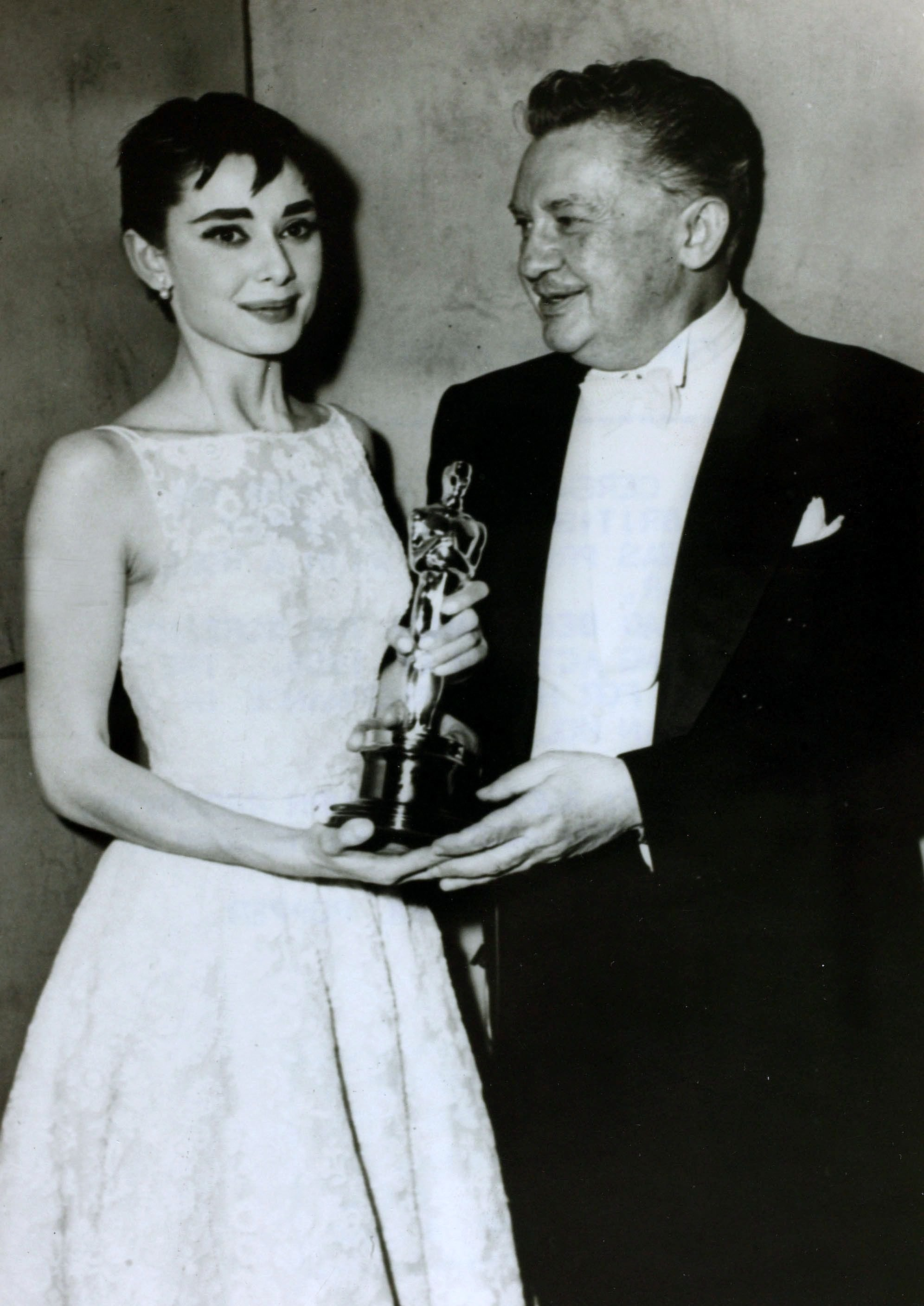 """Audrey Hepburn receives her Oscar as Best Actress for her role in """"Roman Holiday""""   Source: Getty Images"""