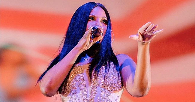 Toni Braxton Flaunts Curvaceous Figure in White Tasseled Bodysuit in Photos from 'Long As I Live' South Africa Tour