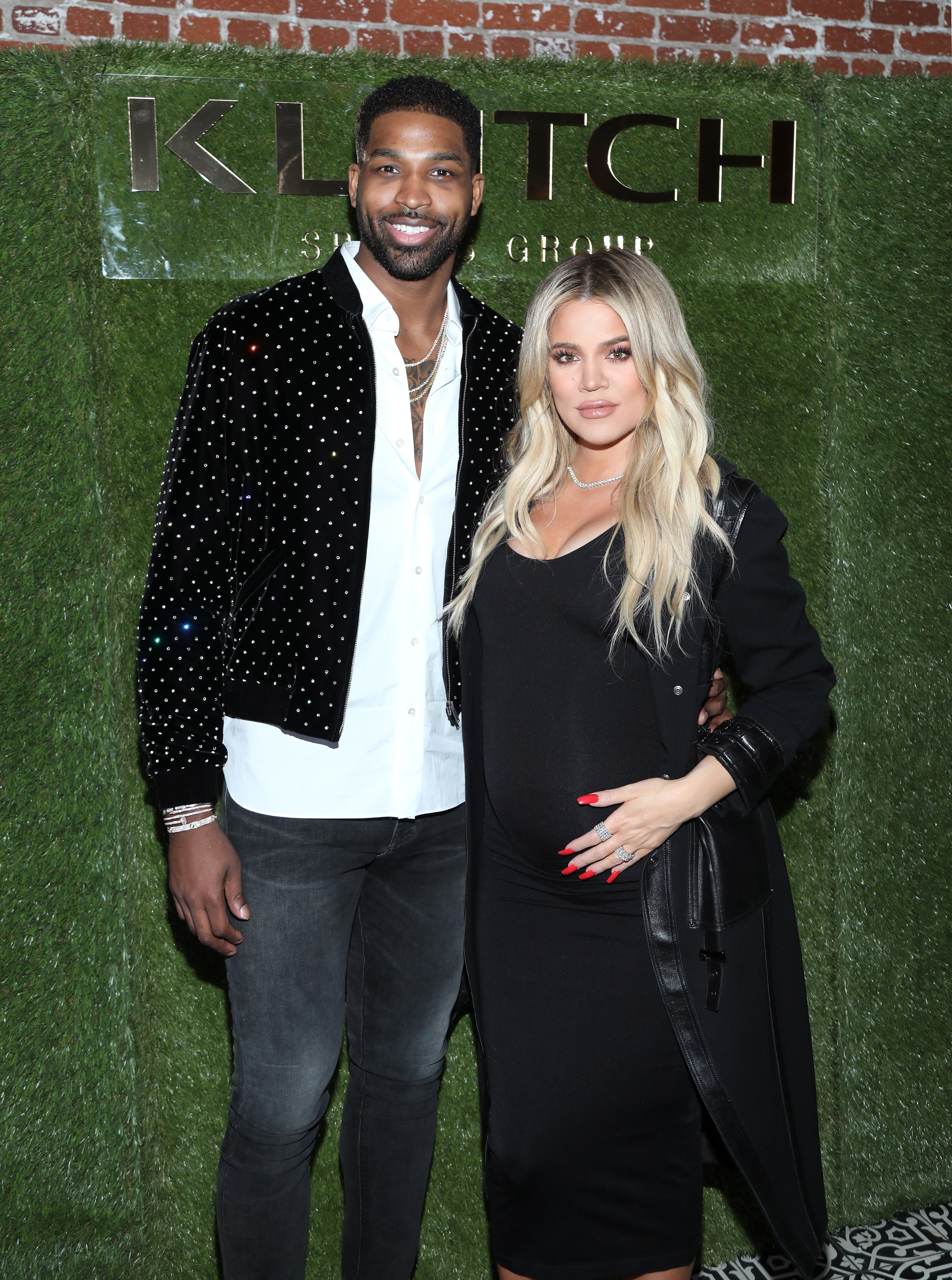 A pregnant Khloe Kardashian and Tristan Thompson at a Klutch Sports event in L.A., February, 2017. | Photo: Getty Images.