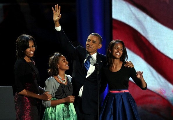 President Barack Obama, Michelle Obama, Sasha, and Malia at McCormick Place November 6, 2012 in Chicago, Illinois | Photo: Getty Images