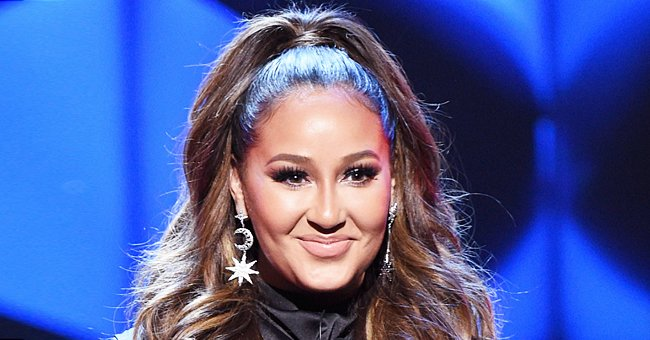 Check Out Adrienne Bailon Spending Quality Time with Her Big Family in Matching White Outfits