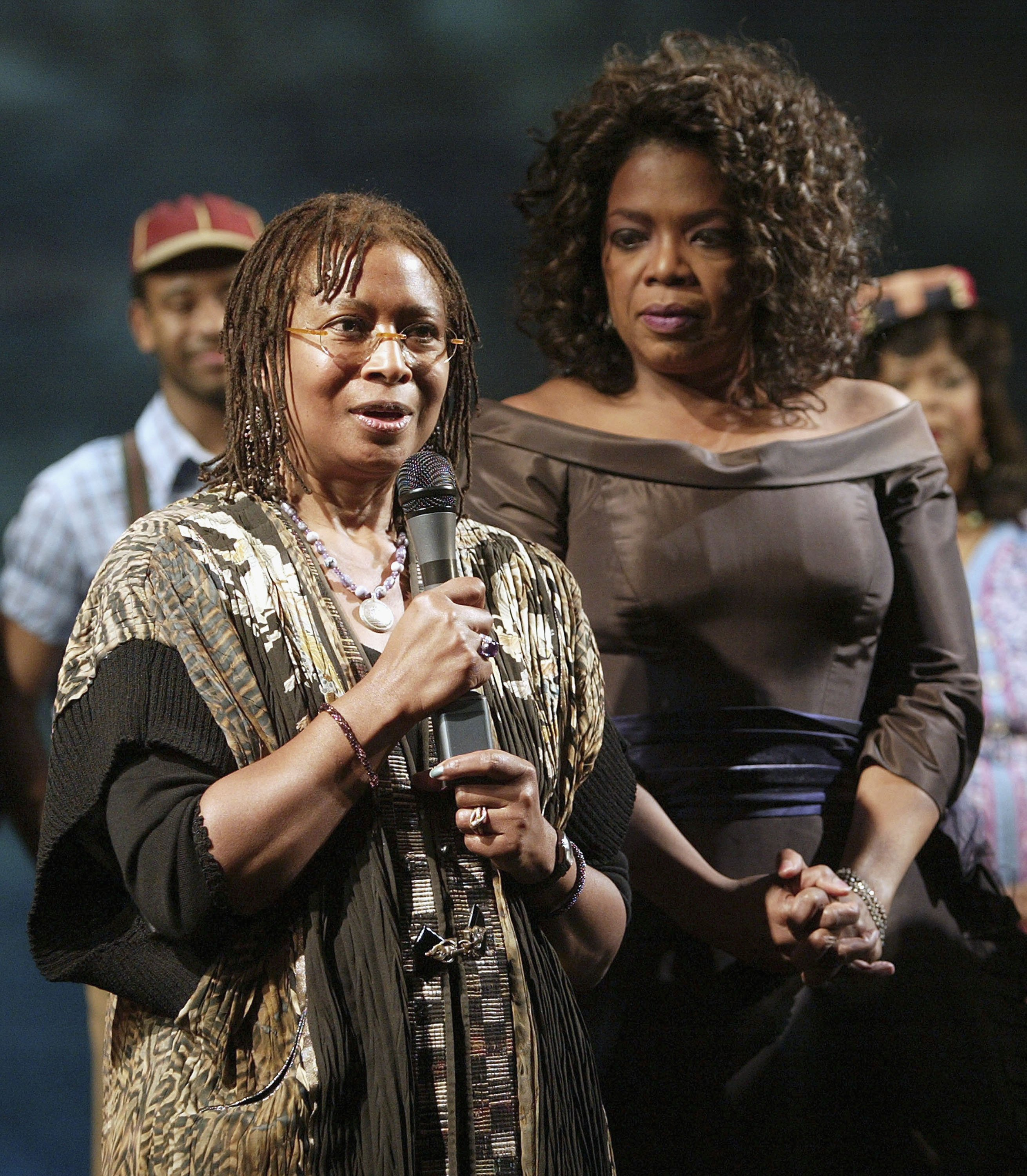 """Author Alice Walker, and Oprah Winfrey at the curtain call for """"The Color Purple"""" at the Broadway Theater on December 1, 2005 in New York City 