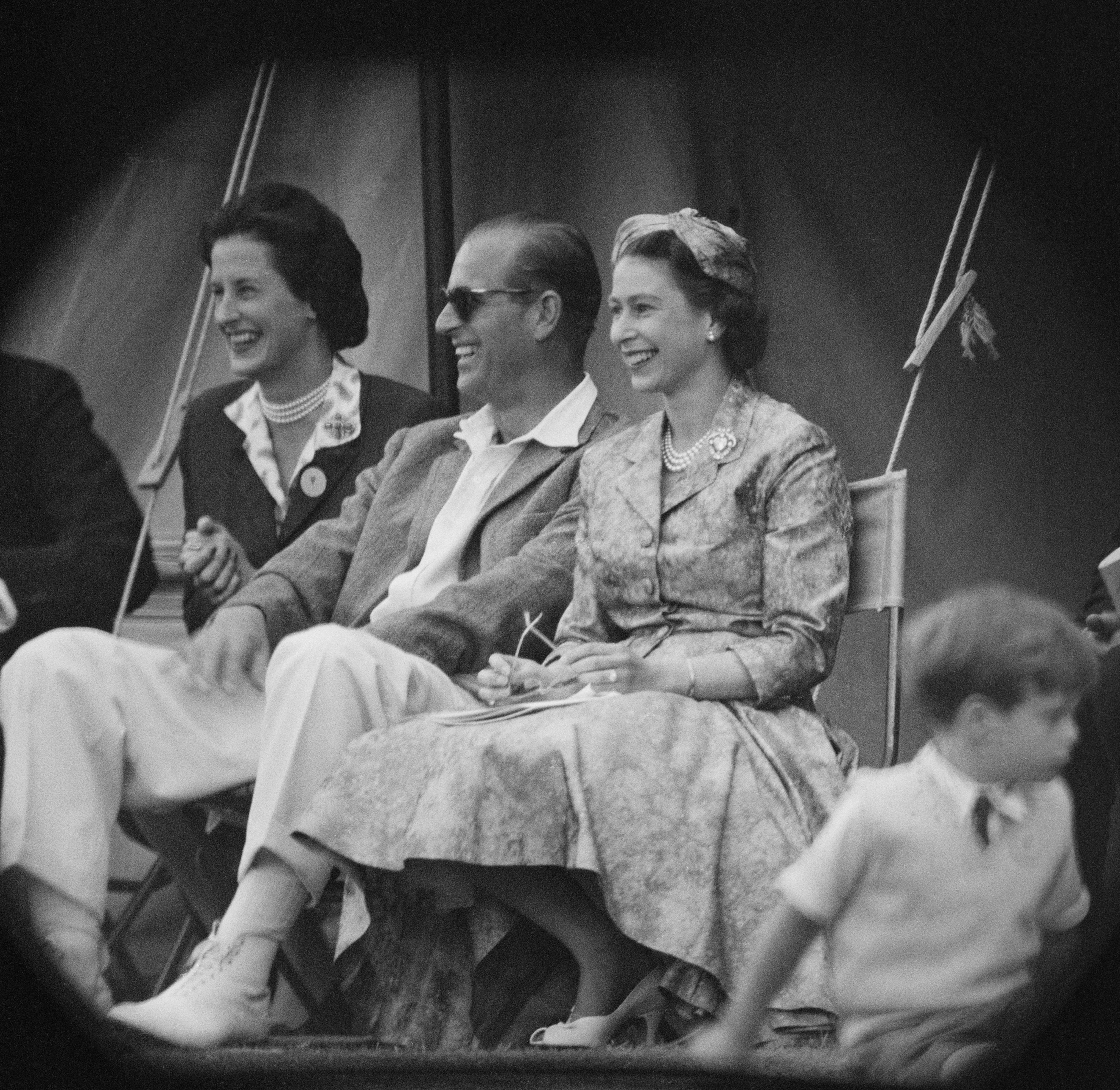 Queen Elizabeth II and Prince Philip watch a cricket match at Highclere Castle in Hampshire, in 1958 | Source: Getty Images