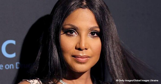 Toni Braxton, 50, defies her age with wavy hair & red lips, showing nude bra in new photo