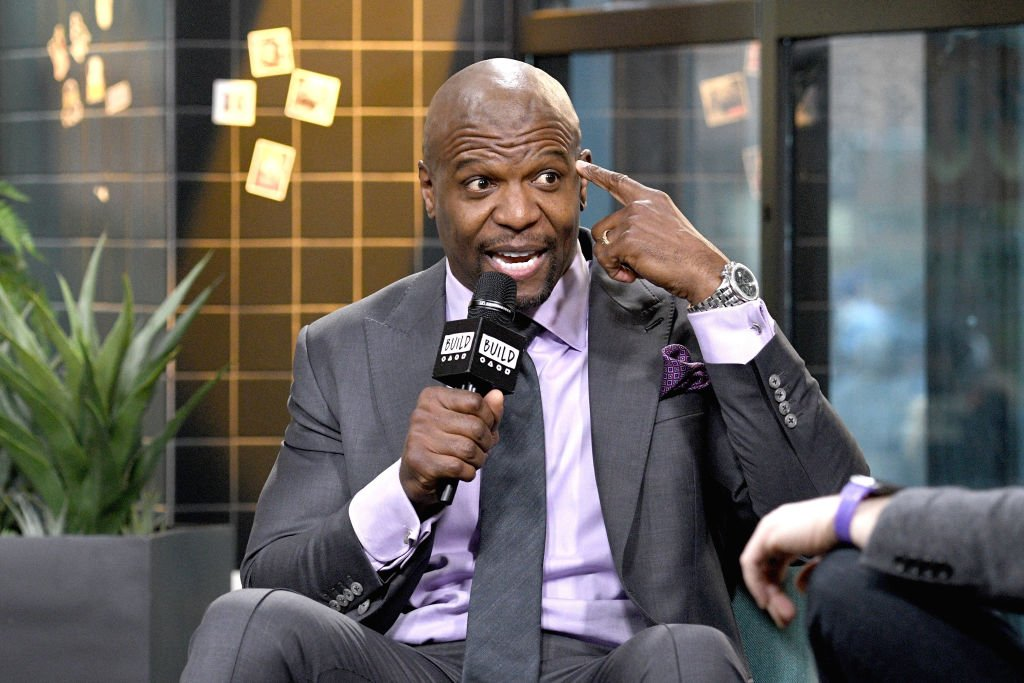 "Terry Crews holds a microphone as he sat on a couch during an interview with the ""Build"" series on January 22, 2020 in New York City. (Photo by Gary Gershoff/Getty Images)"