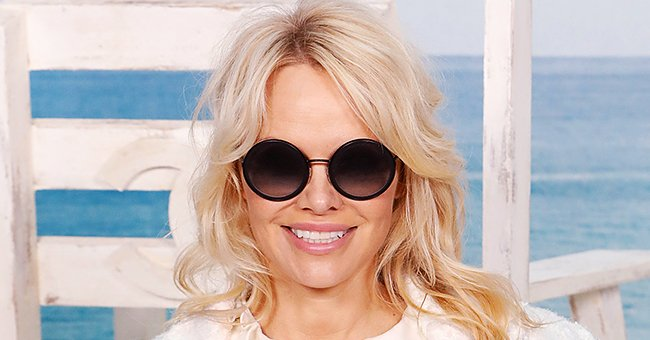 Pamela Anderson Flaunts Figure in Skintight Wetsuit on Beach While Recreating 'Baywatch' Scenes for an Advert