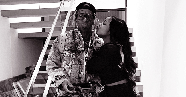 Reginae Carter Gives Father Lil Wayne a Kiss on the Cheek in Rare Photo