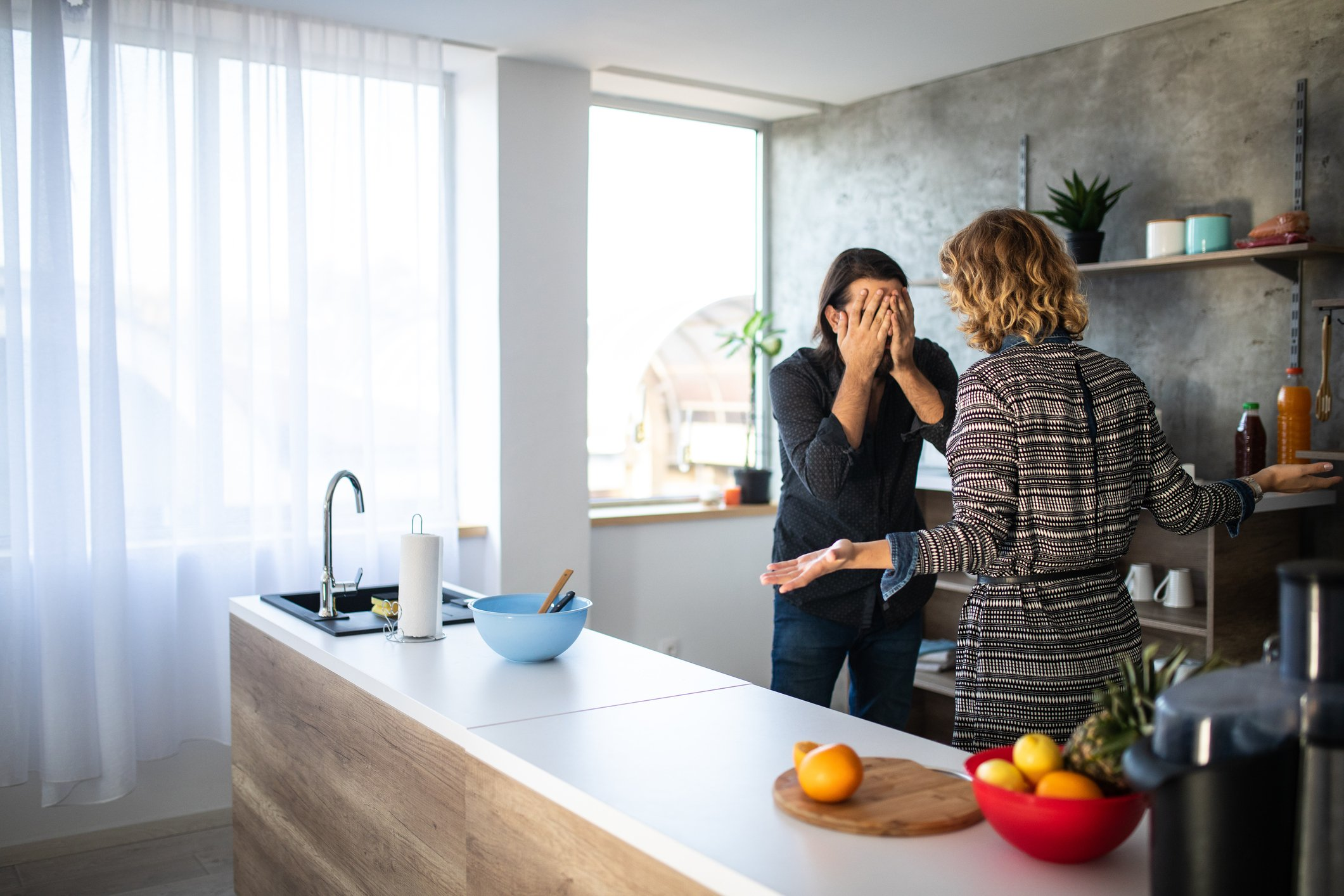 A man and a woman having argument in the kitchen in the morning | Photo: Getty Images