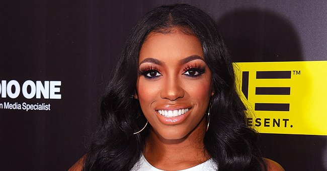 Porsha Williams Flaunts Her Figure in a Matching Orange Top and Skirt Ensemble during Date Night