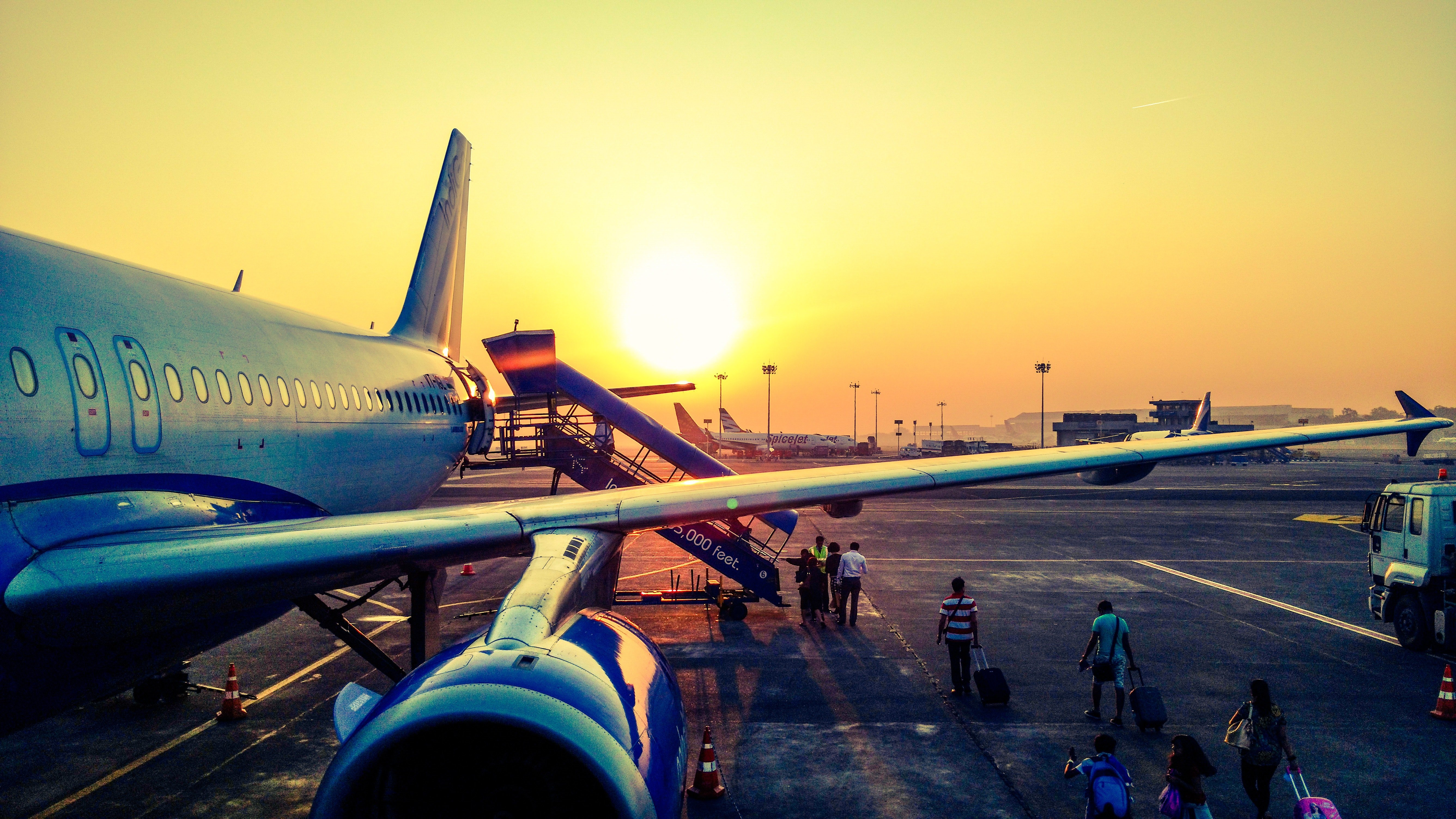 Pictured - Passengers boarding a plane | Source: Pexels