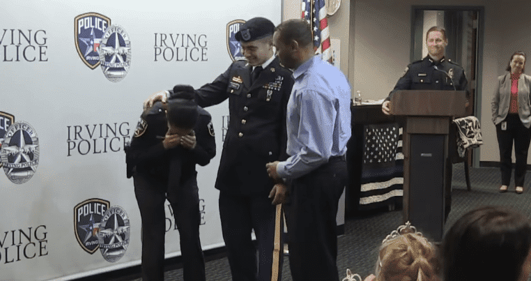 Erika Benning burst into tears as her son, Giovanni Pando surprises her at her swearing-in ceremony as a police officer at the Irving Police Department in Dallas, Texas. | Source: Facebook/Irving Police Department.