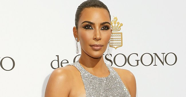 Check Out Kim Kardashian as She Flaunts Her Toned Figure Rocking a Gold-Print Strappy Bikini