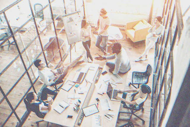 Employees in a meeting in a conference room. | Photo: Shutterstock
