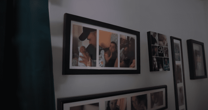 Potraits of Black holding his son hung on his wall   Source: YouTube/CNN