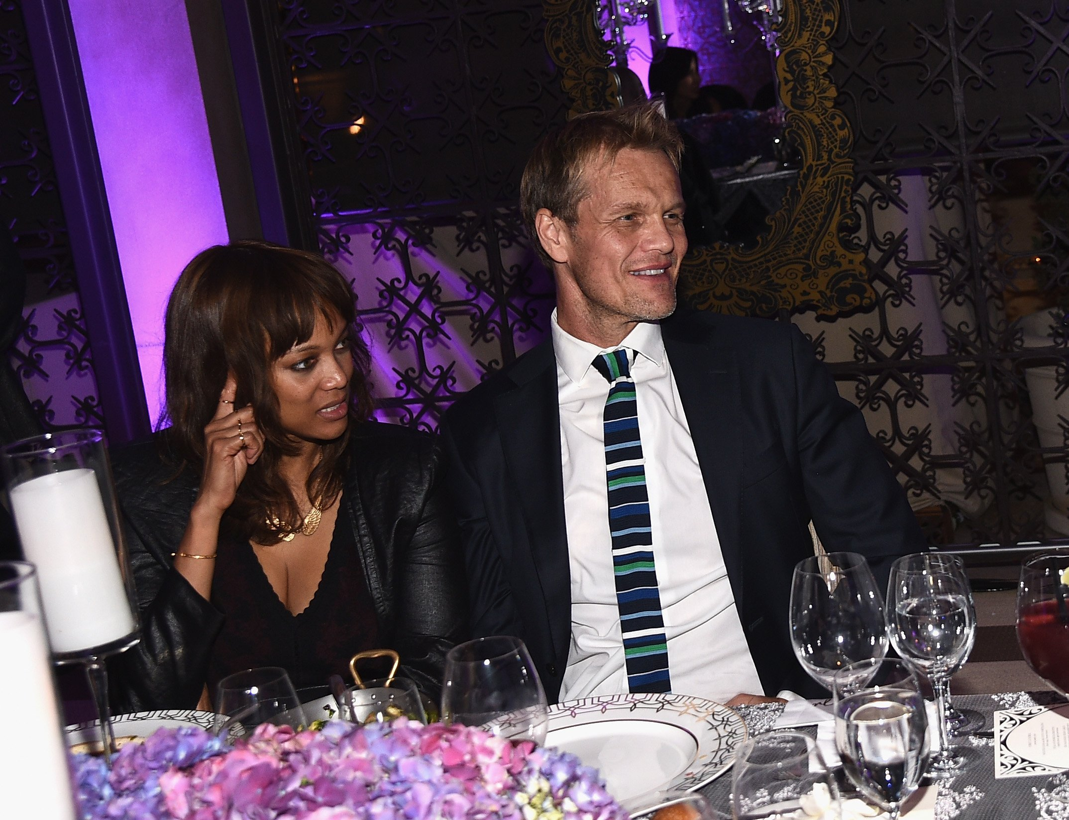 Tyra Banks and photographer Erik Asla attends the August Getty Atelier Dinner at the Montage Hotel Rooftop Grill on November 19, 2014 in Beverly Hills, California. | Source: GettyImages