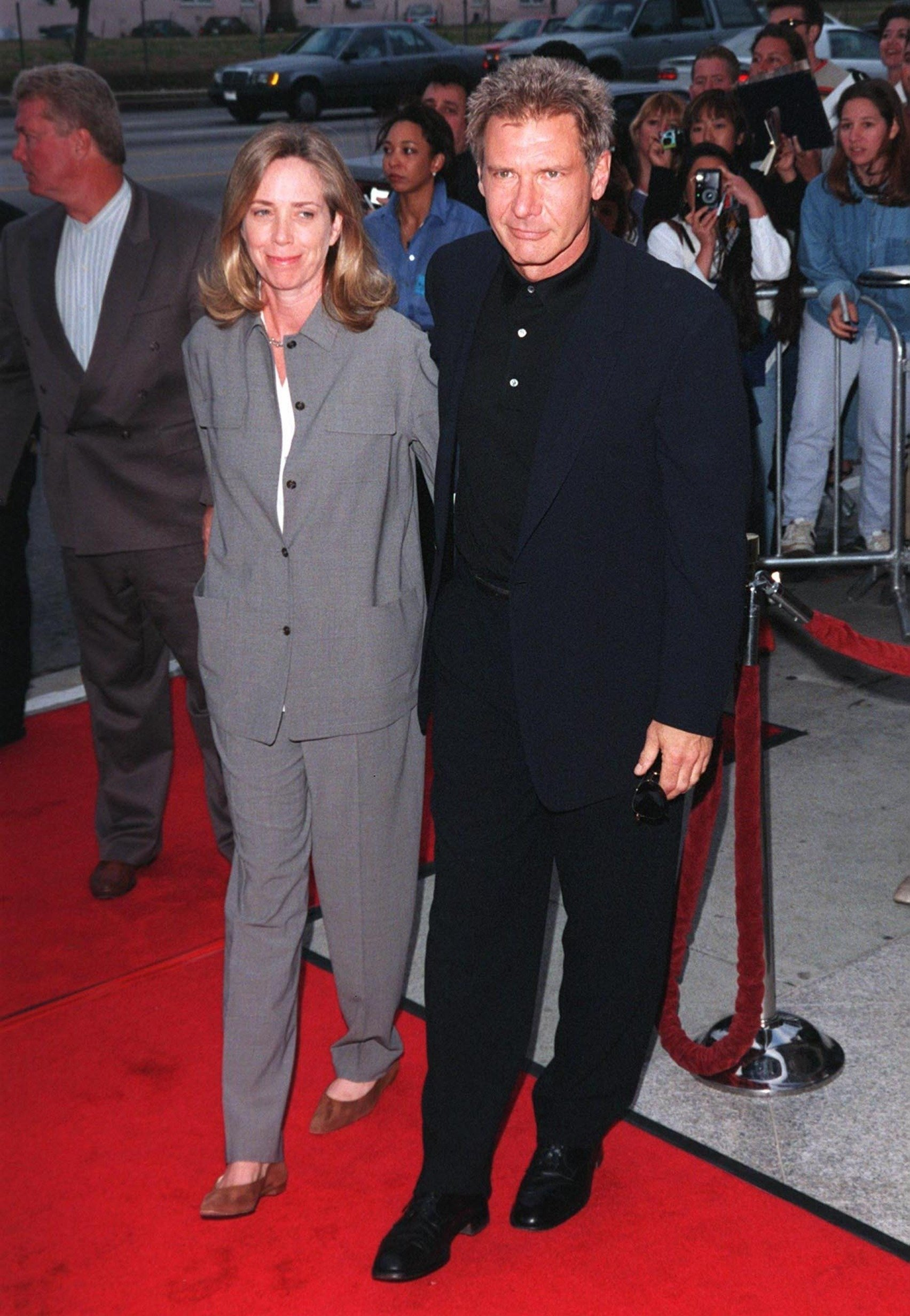 """Actors Harrison Ford with his wife Melissa Mathison at premiere of his movie, """"Six Days, Seven Nights"""" on June 8, 1998   Photo: Shutterstock"""