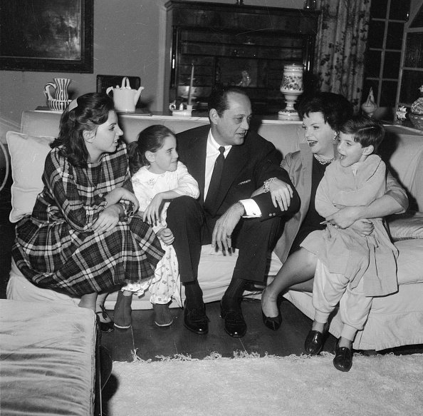 American film star, Judy Garland (1922 - 1969) with her husband, Sid Luft and their children, Liza (14), Lorna (7) and Joe (5) at their home in Chelsea, London | Photo: Getty Images